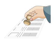 A man hand holding a seal on a ballot  to vote Royalty Free Stock Image