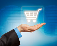 Man hand holding shopping cart icon Royalty Free Stock Photography