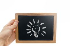 Man hand holding a small blackboard or chalkboard against white background isolated royalty free stock images