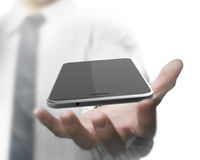 Man hand holding smart phone with black touchscreen Stock Image