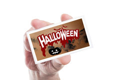 Man hand holding spooky Halloween party card or invitation Stock Photos