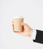 Man hand holding take away coffee Royalty Free Stock Photos