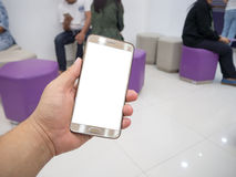 Man hand holding touch screen smart phone with white blank empty screen Royalty Free Stock Photos