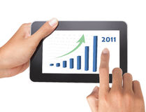 Man hand holding a touch tablet of growing chart Royalty Free Stock Photos