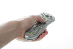 Man Hand holding a TV remote control over white Royalty Free Stock Photo