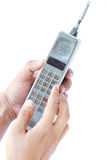 Man hand holding vintage mobile phone Royalty Free Stock Photo