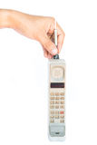 Man hand holding vintage mobile phone Isolated Royalty Free Stock Photography