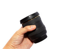 Man hand holding a wide angle lens. Royalty Free Stock Images