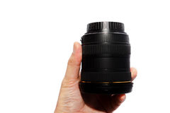 Man hand holding a wide angle lens. Royalty Free Stock Photos