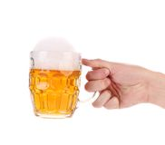 Man hand holds beer in mug. Stock Photos