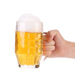 Man hand holds beer in mug. Royalty Free Stock Photography