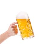 Man hand holds beer in mug. Stock Image