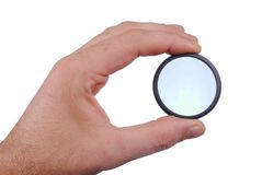 Man hand holds a circular polarize filter Royalty Free Stock Photos