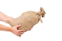 Man hand holds full tied up sack. Stock Images
