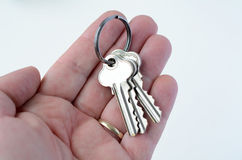 Man hand holds keys. On white background. Concept photo of new home, new house, new office, new life, home loan , mortgage,  finance ,banking Royalty Free Stock Photo