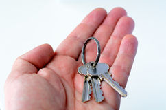 Man hand holds keys. On white background. Concept photo of new home, new house, new office, new life, home loan , mortgage,  finance ,banking Royalty Free Stock Photos