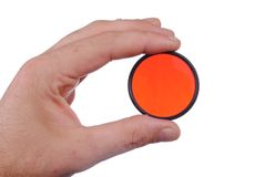 Man hand holds a red photographic filter Royalty Free Stock Images