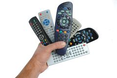 Man hand holds six remote control. Isolated on white background Royalty Free Stock Images