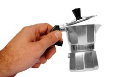 Man hand holds a typical italian Moka Royalty Free Stock Photo
