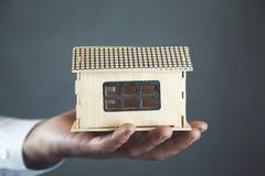 Man hand house model stock photos
