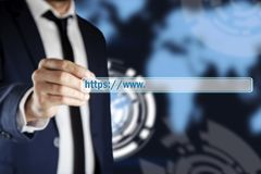Man hand https in screen royalty free stock photos