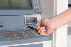 Man hand inserting credit card in an atm Stock Photography