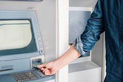 Man hand inserting credit card in an atm. Man hand inserting a credit card in an atm for cash  withdrawal Stock Image