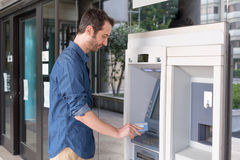 Man hand inserting a credit card in an atm Stock Images