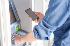 Man hand inserting a credit card in an atm Royalty Free Stock Photos