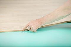 Man hand installing plank Royalty Free Stock Image