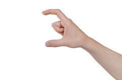 Hand gesture - two fingers holding something. Man hand isolated on white background. Hand gesture - two fingers holding something Royalty Free Stock Photo