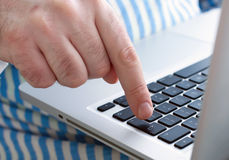 Man hand on a keyboard Stock Photography