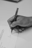 A man hand making the signature. On the form Stock Photo