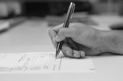 A man hand making the signature. On the form Royalty Free Stock Image