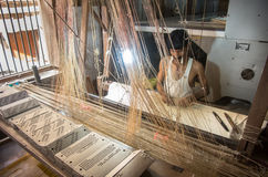 Man hand making a traditional sari in an old fabric factory Stock Photos