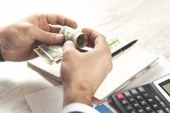 Man hand money and calculator royalty free stock photo