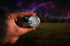 Man hand and moon Royalty Free Stock Photo