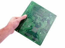 Man hand with a  mother board Royalty Free Stock Image