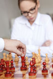Man hand move king on chessboard Stock Images