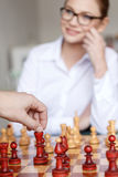 Man hand move with king on chessboard Stock Photo