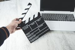 Man hand movie sign. On computer keyboard stock photo