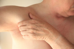 Man with hand near armpit Stock Photography