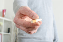 Man hand offering a cigarette Stock Photos