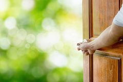 Man hand open door. Handle the rocking shaft or opens empty room door to nature stock images