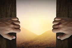 Man Hand Open Door Into Mountain Stock Photos