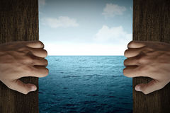 Man hand open door into the sea Royalty Free Stock Image