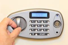 Man hand open of electronic home safe. Stock Photos