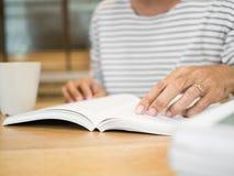 Man hand open and reading a book. Closeup man hand open and reading a book Royalty Free Stock Image