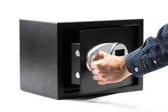 Man hand opened a safe deposit box Stock Image