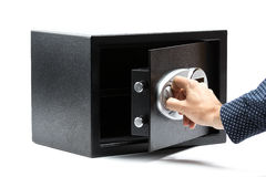 Man hand opened a safe deposit box. On a white background Stock Photo